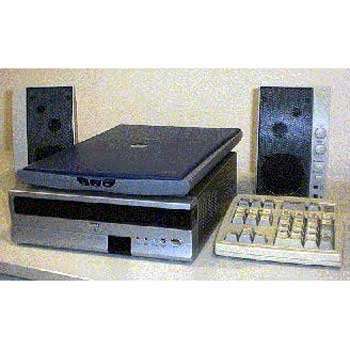 Two black speakers, a light grey flatbed scanner, a rectangular reader under the scanner, and an oversized keypad.