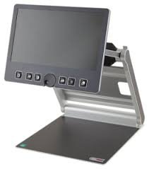 Dark gray, blank, flat display screen attached to a folding arm connected to a flat platform.