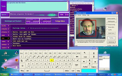 Screenshot of the speech program (top left),  an on-screen keyboard (below) and a head control program (middle right)