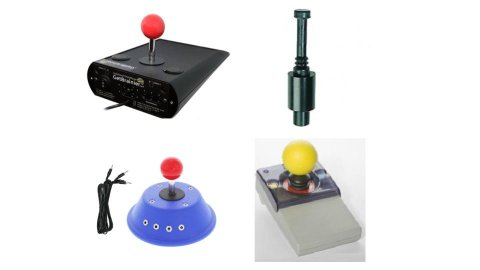 Various models of joystick switches. They resemble standard wheelchair joysticks, with long, thin switches with either a small knob or ball on top for the user to grasp and push/pull the switch. One model has a large yellow ball grip; two have smaller red ball grips. One model has a flat black knob or button grip. The joysticks are embedded in small control devices roughly the size of a wheelchair joystick box. These are either rectangular or circular in shape. One is blue; two are black; one is grey.