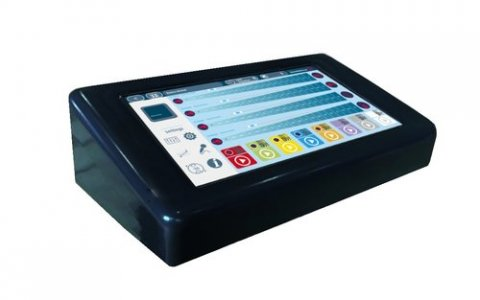 Angled view of rectangular black electronic device with a display showing control button choices and sound indicators.