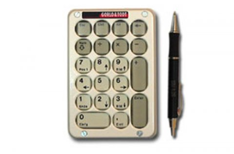 Vertical rectangular gold numeric keypad with pen along right side.
