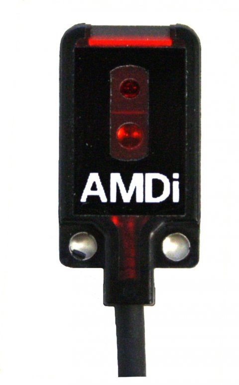 A black rectangular device with a red light at the top and a cord on the bottom.