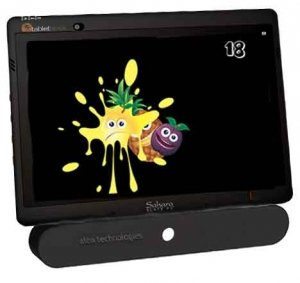 Tablet with an oblong, eye-gaze camera mounted to the bottom. On the screen is a bright splash of yellow color with eyes and a mouth, followed by pineapple and plum.