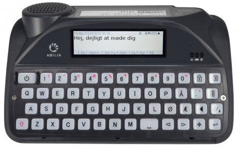 A black keyboard with gray keys, a gray screen above the keys, and a second gray screen with a black speaker on the back of the device.