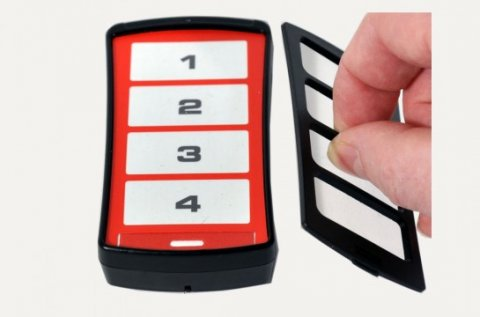 A black rectangular device with white buttons containing the numbers 1 through 4. The top has been removed to expose a red curve indicating overlay options.