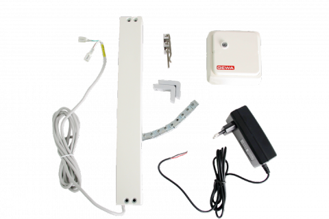 Two white rectangular objects with corresponding parts and a black power cord.