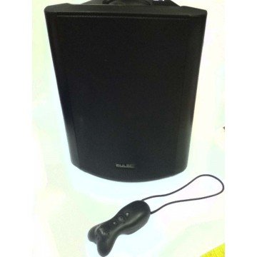 A black rectangular speaker with an elongated black transmitter with menu buttons and a loop attached to the top.