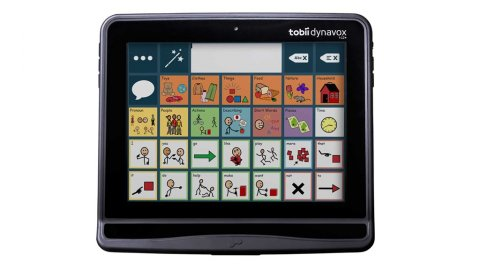 A colorful grid of various symbols used for communication displayed on a small tablet device.