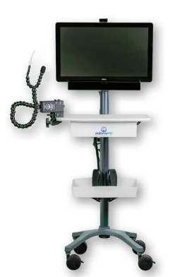 A powered-off display screen on a rolling stand that has two integrated trays. At the side is shown a sip and puff system with tubing and a mounting clamp.
