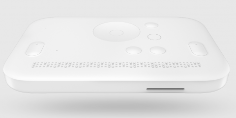 A white rectangular device with various menu options and braille cells below.