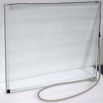 A square glass screen with a white frame and a cord attached to one of the edges.