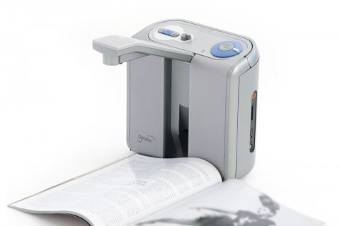 The device with a book placed in front of it and the camera pulled up to a position over the book.