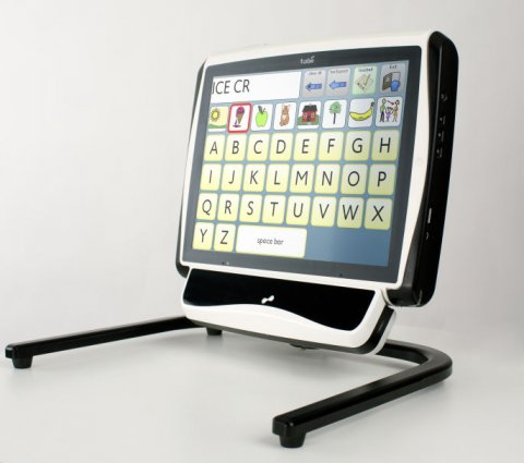 Computer monitor on a stand with a rectangular unit attached to the bottom of the display.