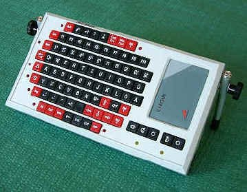 Wired, rectangular keyboard with legs and keypad on right.
