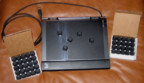 Rectangular Multi Function panel with a USB connector and extra black square keys are shown. There are 5 keys arranged on the clear tray.