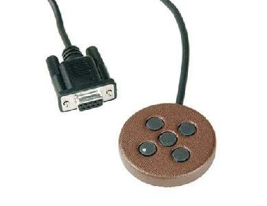 Small, round, copper-colored disc with five small buttons and a serial port connector.