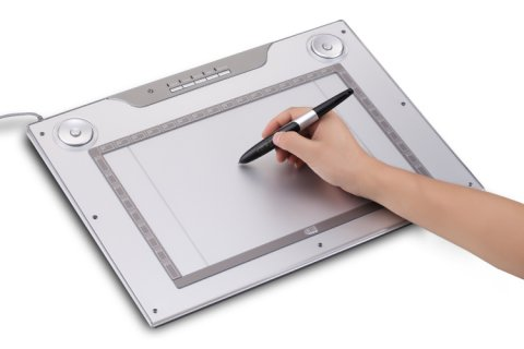 white tablet in use with a hand holding a stylus