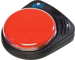 A palm sized black device with big red button on it. There is a small speaker at top right corner of the device.