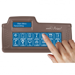 The Primo! Environmental Control Unit with a finger touching the display. The unit is brown, an irregular rectangle in shape, and has an interactive display showing control options. A smaller display is at the top-left of the unit.