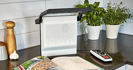 Small, rectangular speaker and document reader.