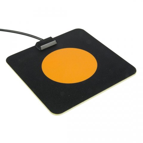 """Large, black, rectangular plate with bright orange circle in the center. The circle switch is flat and completely """"flush"""" with the plate."""