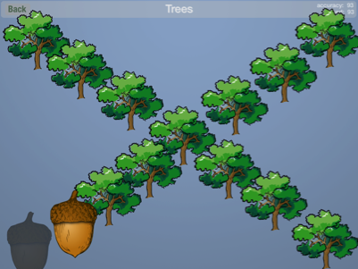 The Ready to print game that has numerous green-boughed trees arrayed in an x across the screen. At the bottom left in positions 1 and 2 of the tree pattern is a silhouette of an acorn instead of the identical tree and in the second position is an actual acorn.