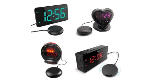 """Various models of extra loud alarm clock with bed shaker. Two of them resemble a standard rectangular alarm clock, but with a small, black, and round component (resembles a """"hockey puck"""") attached to it via cord. Two of the alarm clocks are smaller; one is a circular clock with a flat base for standing upright. The other is small and heart-shaped. One model has teal clock numbers; two have red; and a fourth has purple clock numbers."""