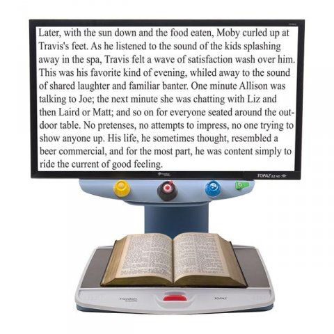 Large rectangular display with white background showing enlarged text connected to a reading table/scanner.
