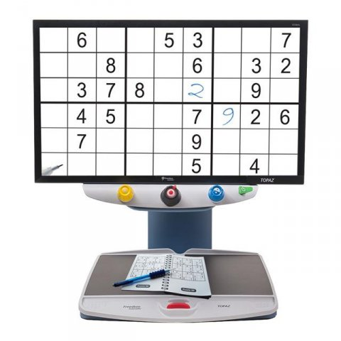 Large rectangular display showing a grid of six enlarged puzzles attached to a reading table/scanner.