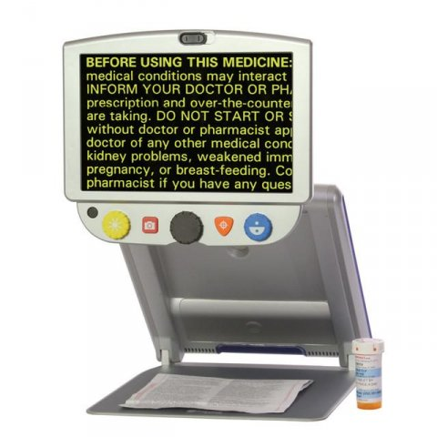 Rectangular display with a control panel attached to bottom connected to a hinged stand and tray with a pill bottle on side.