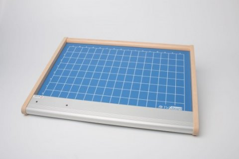 A large, thin square device with a turquoise grid.