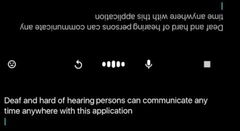 A screenshot of a phone with a black background and white text in landscape at the bottom, and which is repeated upside down at the top.  In the center of these are buttons for replay, volume down and stop.