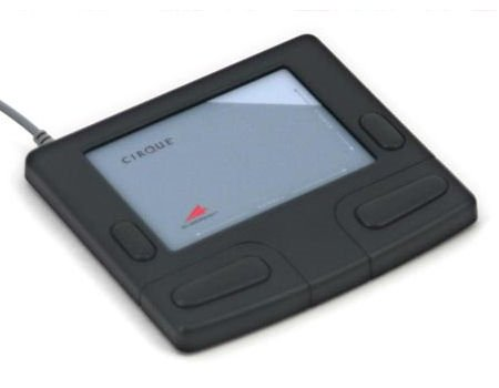 Flat, rectangular, black device with touchpad in center and four buttons on either side of touch pad and two on the bottom.