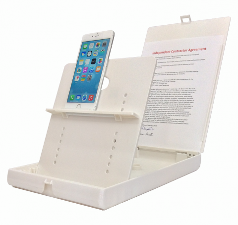 White portable stand with two flaps, the one in front has a ledge to prop a device on and the back one has the document to be scanned. This image version is seen holding an iPhone.