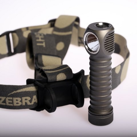 Headlamp and headband with removable top strap and black silicone holder.