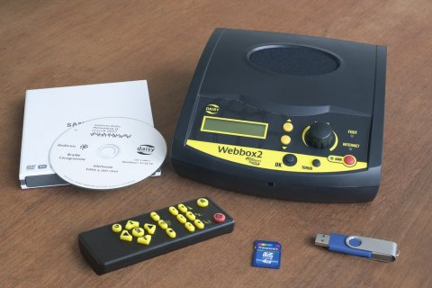 Webbox2 with remote control, CD, manual, USB, and SD card.