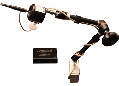 Black joystick mounted on an adjustable arm, with a separate battery shown next to it.
