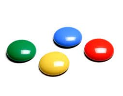 Small, round, button-style switches, shown here in green, yellow, blue, and red.