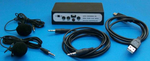 A rectangular device with two microphone ports, a 3.5mm port, and an on/off switch. The accompanying cables and microphones are also pictured.