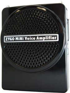 Small black speaker on a thin and compact device. Across the front, the brand name ZYGO MiNi Voice Amplifier is printed in white.