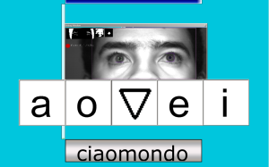 """A screenshot of a user using CiaoMundo's 5-letter, eye-controlled keyboard with predictive type. The screen shows 5 symbols, """"a,"""" """"o,"""" a small triangle, and """"i."""""""