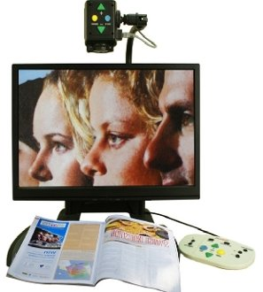 Monitor with magnifier mounted at the top with controls to zoom and a light attached.