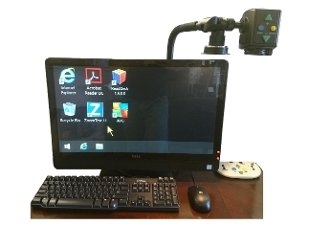 Monitor with magnifier mounted to top right with controls to zoom and a light attached.