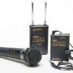 Wireless Audio System consisting of one transmitter, with a clip on lapel mic attached by a cable, a handheld mic, and a dual channel receiver with 2 short antennae.