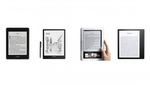 Medium-sized tablet devices with digital book pages. They are roughly the size of a standard paperback book. Three have black borders, while one is a white device. One of the e-readers is shown with a stylus. The e-readers do not have color screens like standard tablets but are black and white and more opaque than a tablet.