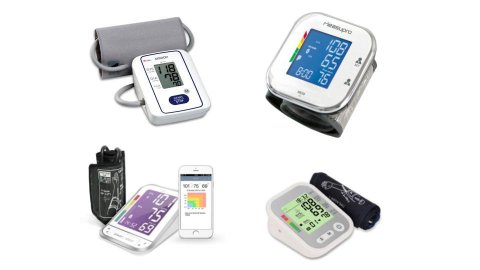 Various models of blood pressure monitors. They resemble small-to-medium-sized rectangular electronic devices with LCD display panels and various menu buttons. They are shown next to arm cuffs. One model is also pictured next to a smartphone with a companion tracking app displaying the results on-screen. Three models are white (two with color display screens); and a fourth model is off-white and grey.