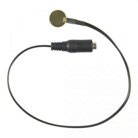 Small, round, corded device, resembling a U.S. quarter coin or a small medallion.