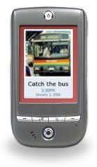 Image of small handheld device showing software on display with a picture of a bus and reminder to board it.