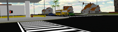 Long, horizontal image of a street intersection, with marked pedestrian crossing lines in the middle.